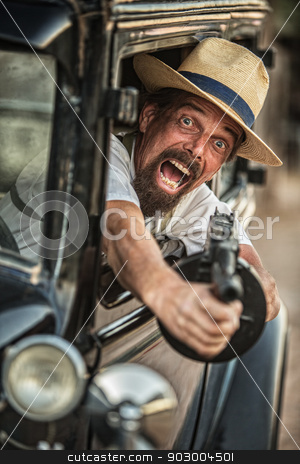 Gangster Firing Machine Gun stock photo, One retro 1920s gangster shooting machine gun  by Scott Griessel