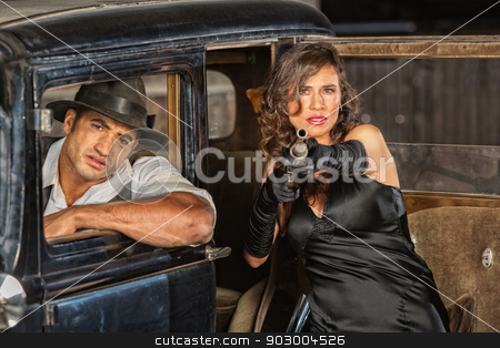 Dangerous 1920s Vintage Gangsters stock photo, Dangerous 1920s vintage gangsters at car with shotgun by Scott Griessel