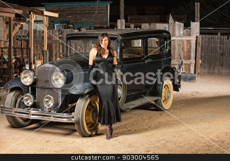 Seductive Woman Leaning on Car stock photo, Sultry woman in black next to vintage automobile by Scott Griessel