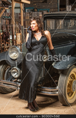 Pretty Woman Leaning on Car stock photo, Pretty woman in black with cigarette leaning on antique car by Scott Griessel