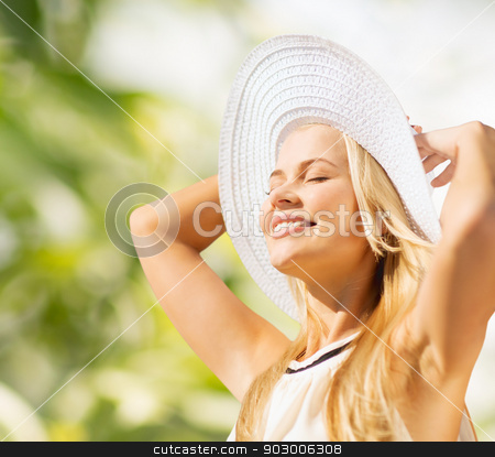 beautiful woman enjoying summer outdoors stock photo, fashion and lifestyle concept - beautiful woman in hat enjoying summer outdoors by Syda Productions