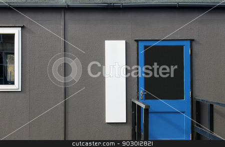 Mobile classroom stock photo, Mobile prefabricated classroom in secondary school. by Martin Crowdy