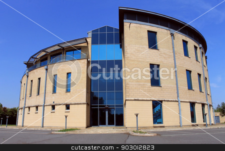 Modern office building stock photo, Exterior of empty modern office building available for lease or rent with blue sky background. by Martin Crowdy