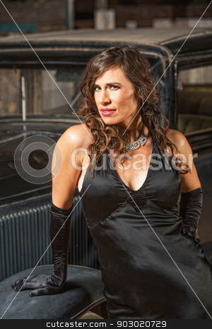 Lovely Mexican Woman by Car stock photo, Lovely Mexican woman in black dress by antique car by Scott Griessel