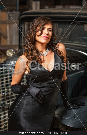 Calm Pretty Woman in Black stock photo, Smiling beautiful woman leaning on antique car by Scott Griessel