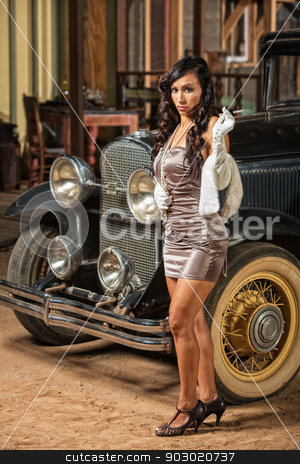 Smoking Retro Lady in Mini Skirt stock photo, Smoking woman in mini skirt and high heels near old car by Scott Griessel