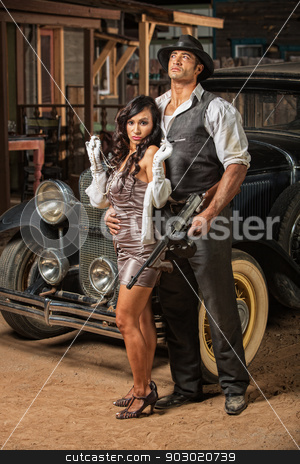 Beautiful Woman with Tough Gangster stock photo, Beautiful woman in mini skirt with tough armed gangster by Scott Griessel