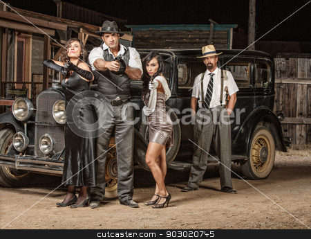 Four Gangster Criminals with Guns stock photo, Dangerous 1920s vintage gangsters outside with weapons by Scott Griessel