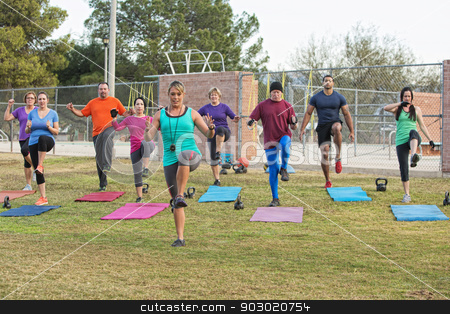 Group of Adults Exercising stock photo, Mixed group of mature adults in boot camp exercise by Scott Griessel