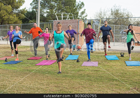 Instructor Exercising with Group stock photo, European female leading diverse group in exercises by Scott Griessel