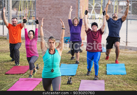 Adult Boot Camp Exercise Class stock photo, Mature adult boot camp fitness class stretching outdoors by Scott Griessel