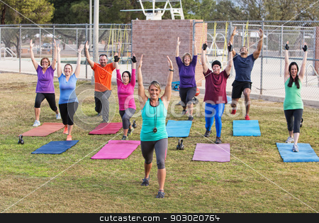 Diverse Group Exercising Outdoors stock photo, Diverse group of adults working out outdoors by Scott Griessel