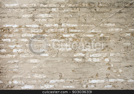 Wall stock photo, Old brick wall made with sand color stones. by Henrik Lehnerer