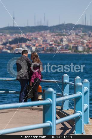 Turkish Couple Along the Bosphorus stock photo,  Young Turkish Couple Along the Bosphorus by Scott Griessel
