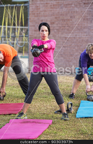 Female Adult Exercising Outdoors stock photo, Female adult in pink exercising at outdoor boot camp by Scott Griessel