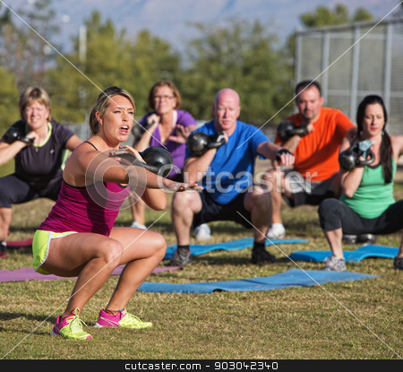 Boot Camp Fitness Trainer Yelling stock photo, Boot camp fitness trainer yelling during squat exercises by Scott Griessel