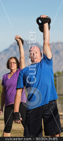 Fit Mature Adults Working Out stock photo, Fit pair of middle aged people exercising with weights by Scott Griessel
