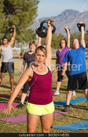 Woman Leading Strength Training Class stock photo, Fit female leading strength training class outdoors by Scott Griessel