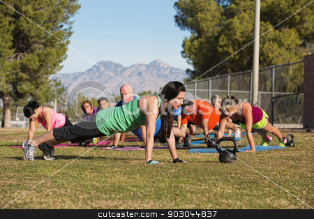 Group Doing Push Ups stock photo, Fitness instructor leading group in push up exercises outdoors by Scott Griessel