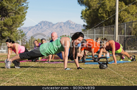 People Doing Push Ups stock photo, Group of adults doing push up exercises outdoors by Scott Griessel