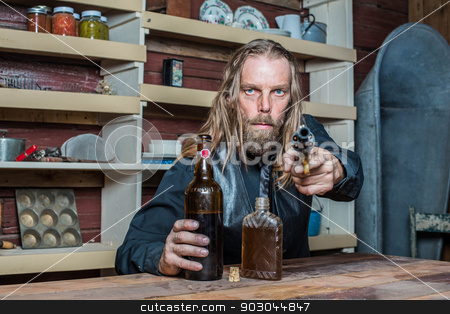 Drunk Western Man at Table stock photo, Drunk Western Man Aims Revolver Towards You as he Sits at Table by Scott Griessel