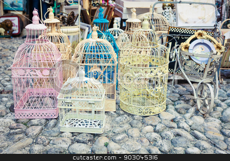 Shabby chic market stock photo, Candid shot of shabby chic vintage cages on a flea market by Natalia Macheda