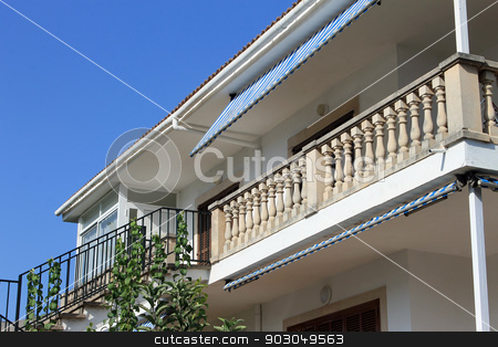 Exterior of Spanish home stock photo, Low angle exterior view of traditional Spanish home with balcony. by Martin Crowdy