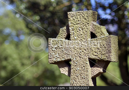 Old cross in cemetery stock photo, Old religious cross in cemetery, Scarborough, England. by Martin Crowdy