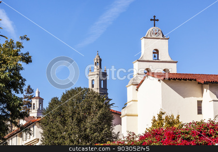 Steeples White Adobe Mission Santa Barbara Cross Bell Bougainvil stock photo, White Abobe Cross Steeples Bell Mission Red Bougainvillea Santa Barbara California.  Founded in 1786 at the end of Father Junipero Serra life. by William Perry