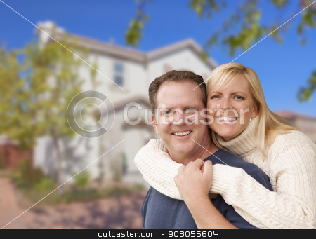 Happy Couple Hugging In Front of House stock photo, Happy Couple Hugging In Front of a Beautiful House. by Andy Dean