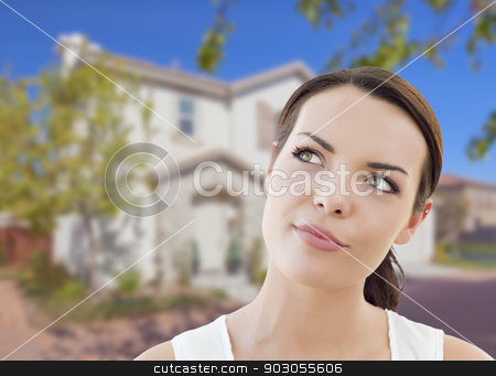 Thoughtful Mixed Race Woman In Front of House stock photo, Thoughtful Pretty Mixed Race Woman In Front of House Looking up and to the Side. by Andy Dean