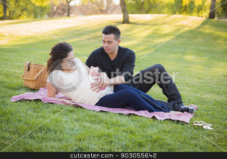 Pregnant Hispanic Couple with Piggy Bank on Belly in Park stock photo, Contemplative Pregnant Hispanic Couple with Piggy Bank on Mother's Belly in the Park. by Andy Dean