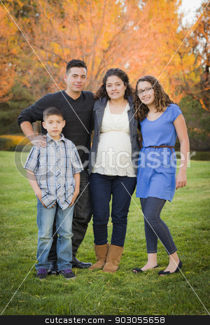 Attractive Hispanic Family Portrait in a Colorful Fall Outdoor S stock photo, Attractive Hispanic Family Portrait in a Colorful Fall Outdoor Setting At the Park. by Andy Dean