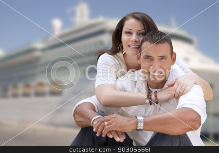 Young Happy Hispanic Couple In Front of Cruise Ship stock photo, Young Happy Hispanic Couple Hugging On The Dock In Front of a Cruise Ship. by Andy Dean