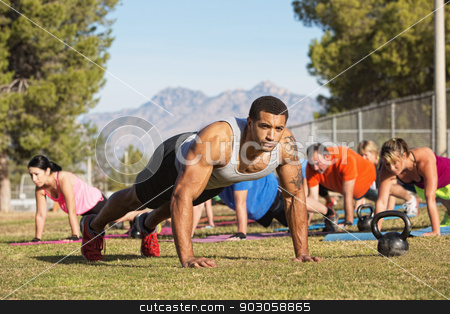 People Working Out Near Mountains stock photo, Muscular instructor and group exercising near mountains by Scott Griessel