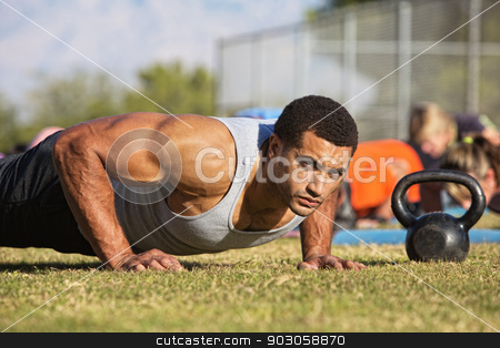 Handsome Man Doing Push-Ups stock photo, Handsome Black man with large biceps doing push-ups outdoors by Scott Griessel