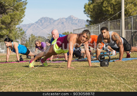 Strong Woman Leading Push-Ups stock photo, Blond fitness instructor leading push-ups near mountain by Scott Griessel