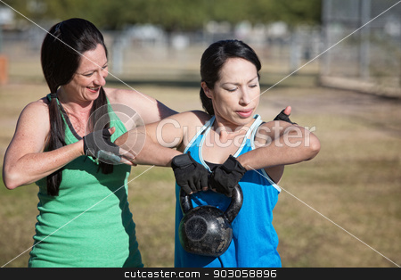 Two Women Working Out stock photo, Two women working out with kettle bell weights by Scott Griessel