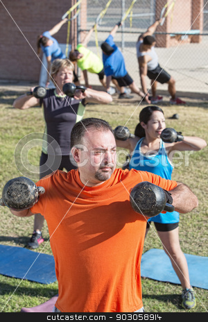 Fit Group in Boot Camp Fitness Class stock photo, Fit mature adults exercising with weights in boot camp fitness class by Scott Griessel