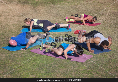 Group Doing Knee Elbow Exercises stock photo, Group of five adults doing knee to elbow push-ups by Scott Griessel