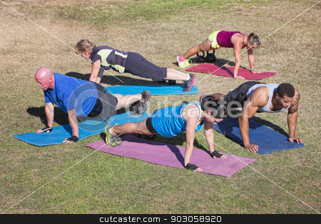 Diverse Group Doing Push-Ups stock photo, Group of five people exercising in outdoor boot camp by Scott Griessel