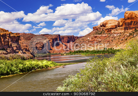 Colorado River Rock Canyon Reflection Green Grass Outside Arches stock photo, Colorado River Reflection Green Grass Red Rock Canyon Outside Arches National Park Moab Utah USA Southwest.  by William Perry
