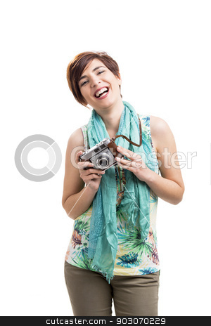 Woman with a vintage camera stock photo, Beautiful and happy woman with a vintage camera, isolated over white background by ikostudio