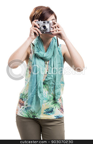 Woman taking a photo with a vintage camera stock photo, Beautiful woman taking a photo with a vintage camera, isolated over white background by ikostudio