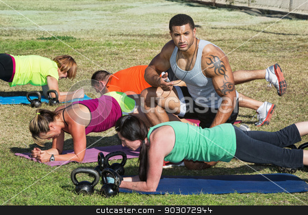 Fitness Trainer Helping Students stock photo, Instructor with tattoo helping bootcamp fitness students by Scott Griessel