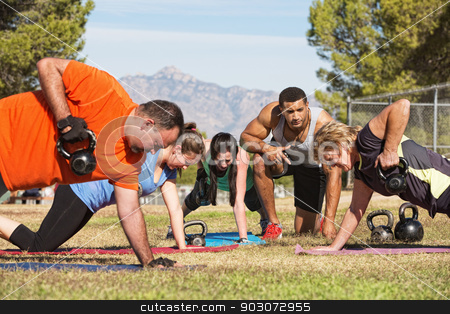 Exercise Group Using Kettle Bells stock photo, Male instructor training mature adults in boot camp fitness by Scott Griessel