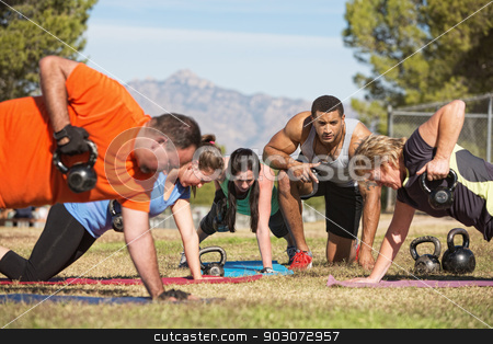 Adults Exercising Outdoors stock photo, Fitness instructor with people exercising in outdoor bootcamp by Scott Griessel
