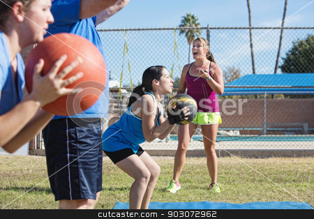 Group Training with Medicine Ball stock photo, Bootcamp fitness instructor training adults with medicine ball by Scott Griessel