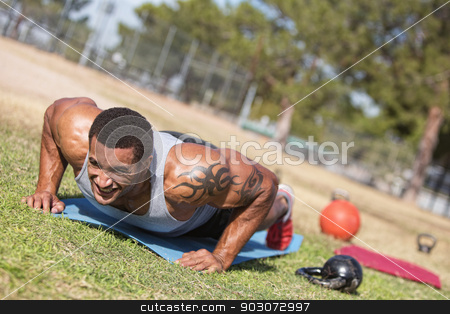 Man with Tatoo Doing Push Ups stock photo, Strong man with tattoo doing push ups outdoors by Scott Griessel