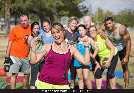 Enthusiastic Fitness Instructor with Group stock photo, Enthusiastic  bootcamp fitness instructor with group outdoors by Scott Griessel